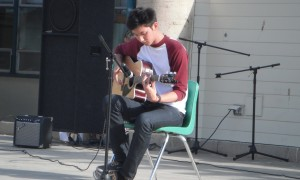 "Evan Ma sings ""These Moments"" by Antoine Dufour on his acoustic guitar."