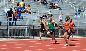 Senior Matthew Speegle races ahead of his competitors in the 100 meters.